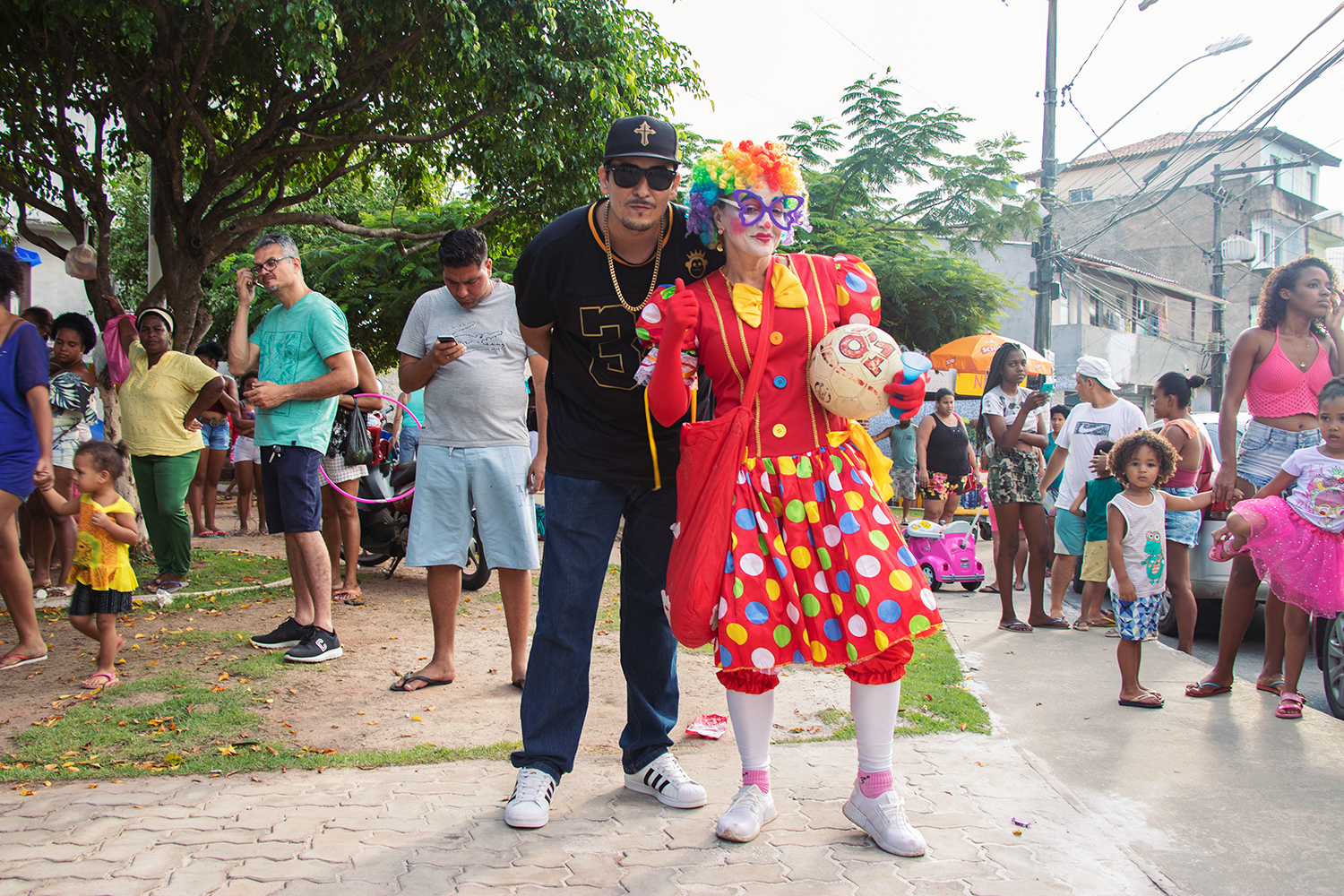 Brazilian Rap Star Kaos MC with the Clown at Kids Day in the Favela