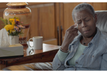 Black elderly woman in pain and crying
